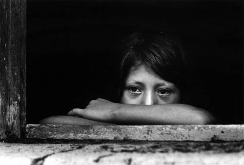 A child at an orphanage for children who have lost their parents in the civil war. Zaragoza, El Salvador. 1982 © M.Kobayashi/Exile Images